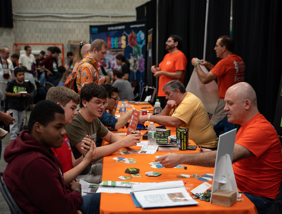 a scene of many people playing tabletop games at bostonfig 2018