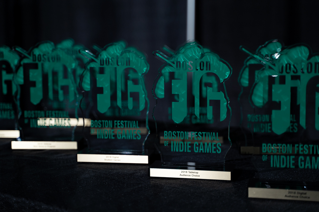 image showing the glass awards from the figgies, the award show after the festiavl