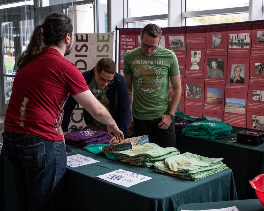 several people working the BostonFIG Fest merchandies booth in 2018.