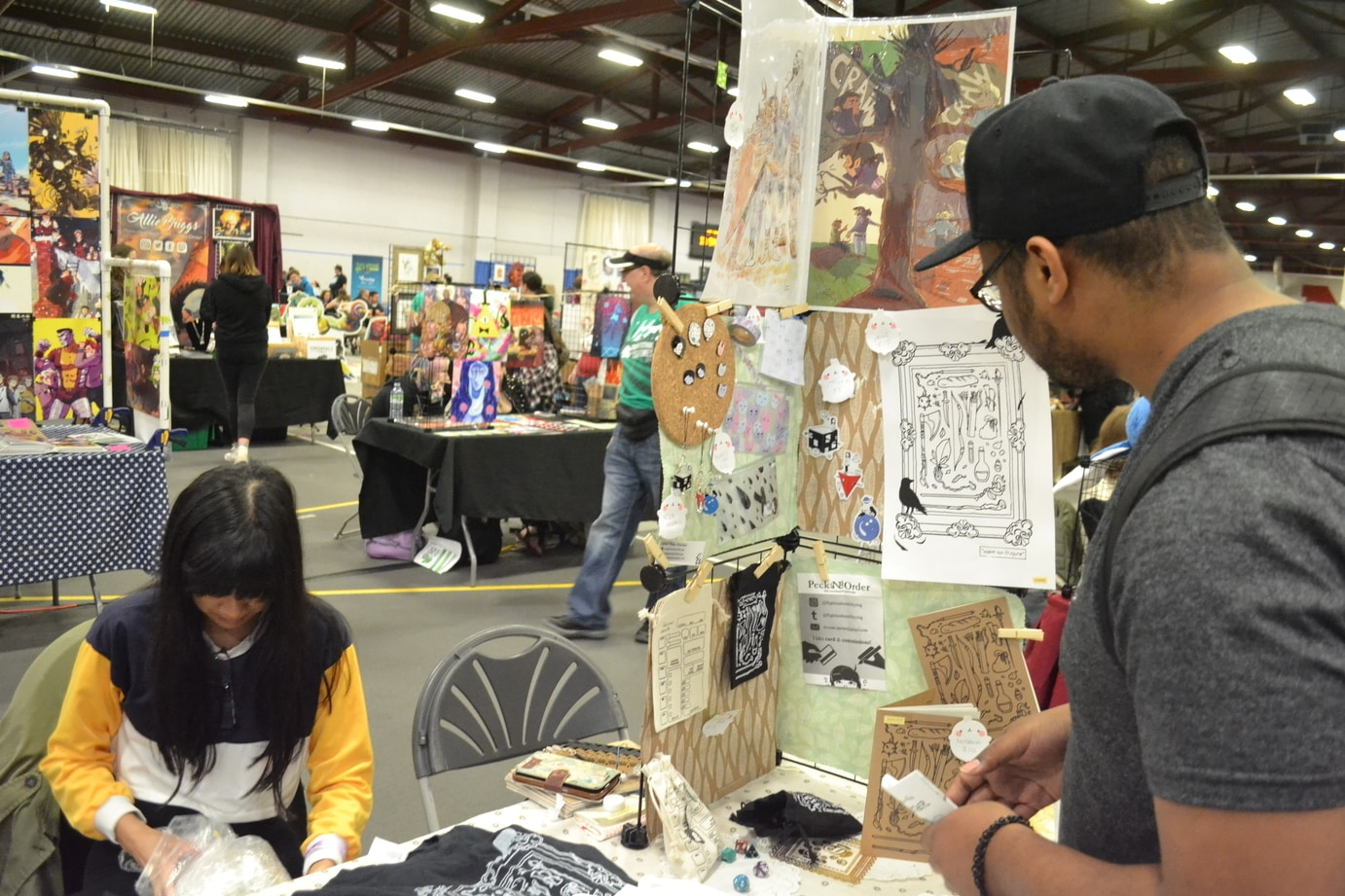 festival artists alley image showing a number of different artist booths with their work on display
